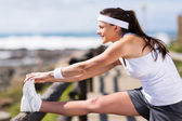 Woman warming up before exercise — Stockfoto
