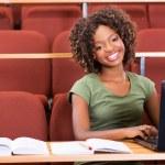 College girl using laptop — Stock Photo #42369219