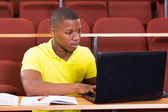 African student using laptop — Stock Photo