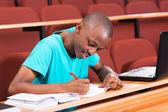 Student writing classwork — Stock Photo