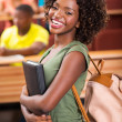 Smiling student in lecture hall — Stock Photo