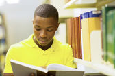 African man reading book — Stock Photo