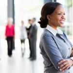 Businesswoman looking outside window — Stock Photo