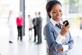 Career woman using cell phone — Stock Photo