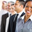 African businesswoman with team — Stock Photo