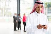Islamic businessman using smartphone — Stock Photo