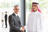 Businessman handshake with Arabian partner — Stock Photo