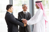 Multicultural business partners teamwork — Stock Photo