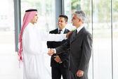 Business partners handshaking — Stock Photo
