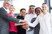 Multiracial business team hands together — Stock Photo