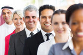 Senior businessman with colleagues — Stock Photo