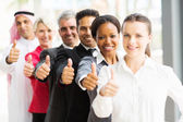 Business team giving thumbs up — Stock Photo