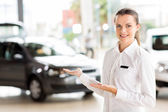 Consultant presenting cars — Stock Photo