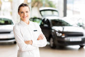 Sales consultant in car showroom — Stock Photo