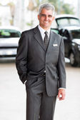 Salesman in showroom — Stock Photo