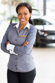 African woman in car dealership — Stock Photo