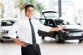 Car dealer in showroom — Stock Photo