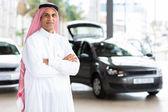 Eastern male car dealer — Stock Photo