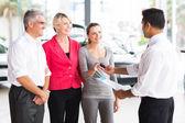 Salesman handing over car key — Stock Photo