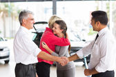 Father buying a car for his daughter — Stock Photo