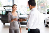 Young woman receiving her car key — Stock Photo