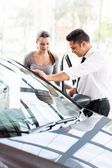 Sales consultant with buyer in showroom — Stock Photo