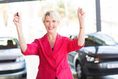 Excited woman pick up her car — Stock Photo
