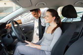 Car sales consultant with potential customer — Stock Photo