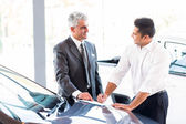 Car salesman made a sale — Stock Photo