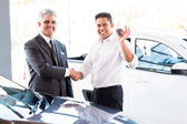 Indian man handshaking with salesman — Stock Photo