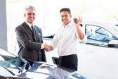 Indian man handshaking with salesman — Stock Photo