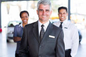 Car dealership principal and staff — Stock Photo