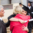 Graduate embracing her mother — Stock Photo