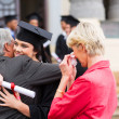 Female graduate hugging her father — Stock Photo #42474065