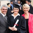 Young graduate with parents — Stock Photo #42474409