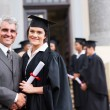 Female graduate with father — Stock Photo #42474835