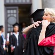 Graduate hugging mother — Stock Photo