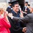 Graduate being congratulated by his father — Stock Photo #42477385