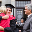 Graduate hugging his mother — Stock Photo #42478293