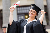 Excited graduate giving thumb up — Stock Photo