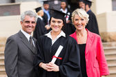 Young graduate with parents — Stock Photo