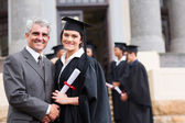 Female graduate with father — Stock Photo