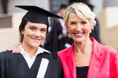 Young female graduate and mother — Stock Photo