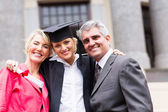 Smiling graduate and parents — Stock Photo