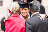 University graduate hugging parents — Stock Photo