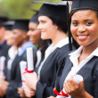 Pretty african graduate at graduation — Stock Photo #42488341