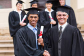 African male graduate with dean — Stock Photo