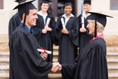 Graduate shaking hand with professor — Stock Photo