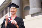 Senior graduate holding certificate — Stock Photo
