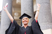 University graduate with arms up — Stock Photo